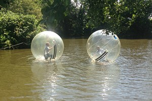 Click to view details and reviews for 2 For 1 Water Zorbing At Pump It Up Events.