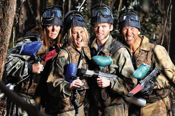 Friends smiling after a paintballing experience in Bedlam Cornwall