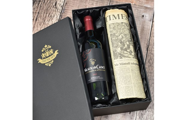 Vintage Bordeaux Red Wine and Newspaper in a Luxury Gift Box