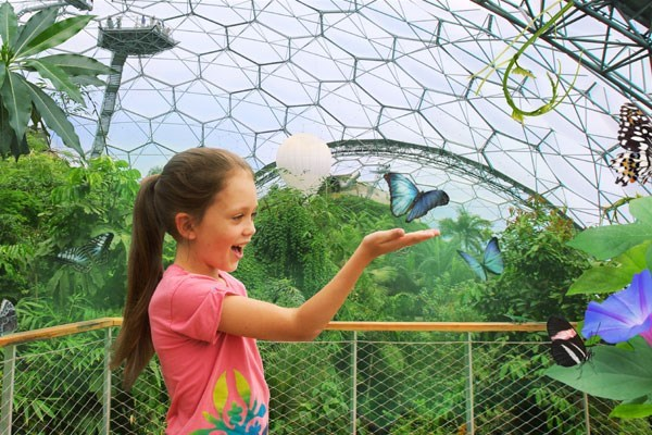 Girl holding a butterfly at the Eden Project in Cornwall